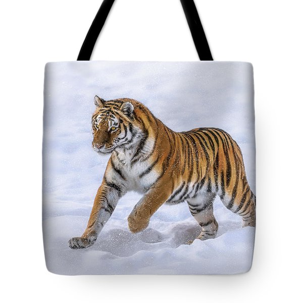Tote Bag featuring the photograph Amur Tiger Running In Snow by Rikk Flohr