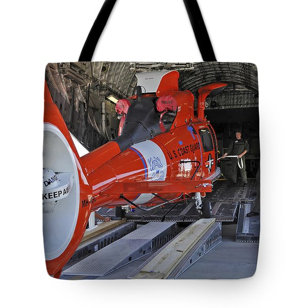 An Aircrew Loads A Coast Guard Hh-65 Tote Bag by Stocktrek Images
