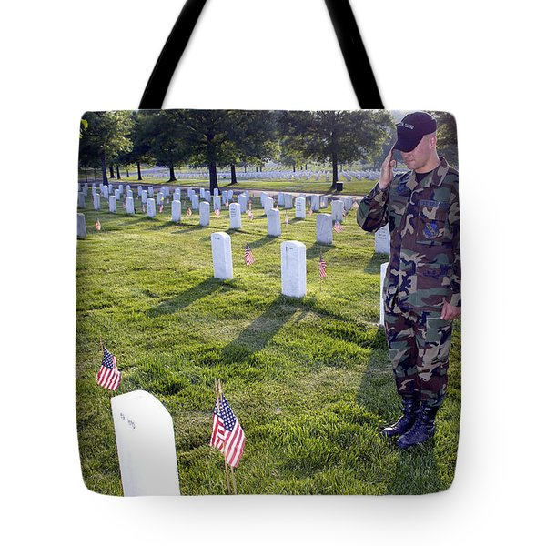 An Airman Renders Honors After Placing Tote Bag by Stocktrek Images