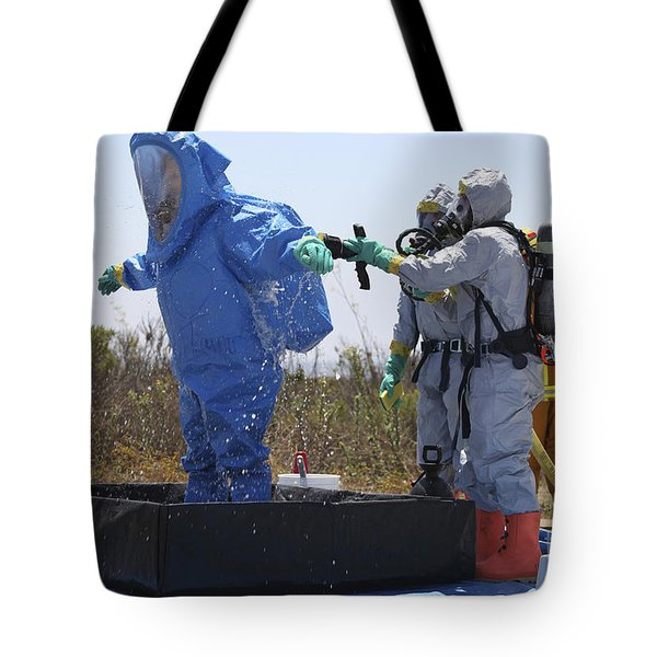 An Airman Stands In A Tub Of Cleaning Tote Bag by Stocktrek Images
