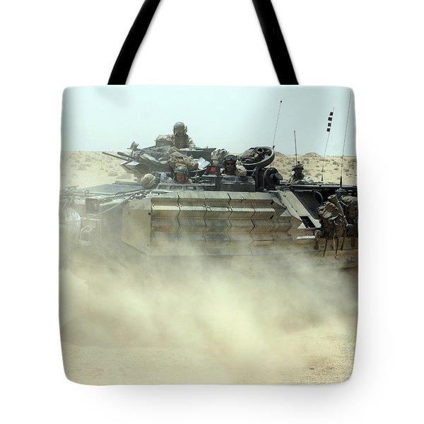 An Amphibious Assault Vehicle Kicks Tote Bag by Stocktrek Images