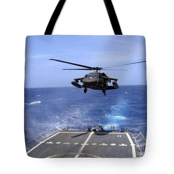 An Army Uh-60 Black Hawk Helicopter Tote Bag by Stocktrek Images