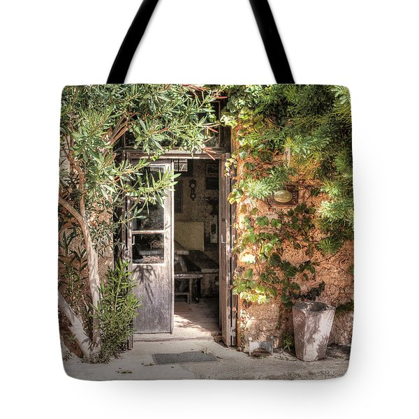 Tote Bag featuring the photograph An Entrance In Santorini by Tom Prendergast