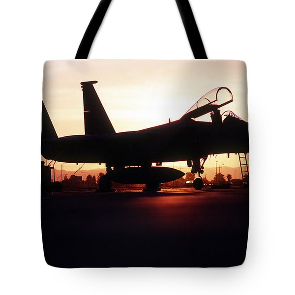 An F-15c Eagle Aircraft Silhouetted Tote Bag by Stocktrek Images