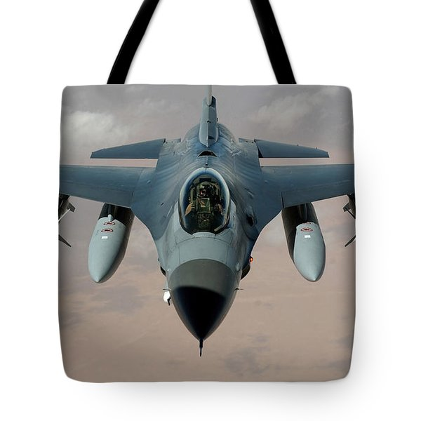 An F-16 Fighting Falcon Flies A Mission Tote Bag by Stocktrek Images