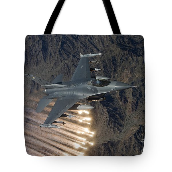 An F-16 Fighting Falcon Releases Flares Tote Bag by HIGH-G Productions