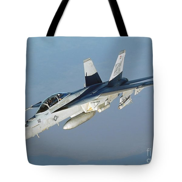 An Fa-18f Super Hornet Conducts Tote Bag by Stocktrek Images