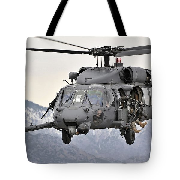 An Hh-60 Pave Hawk Helicopter In Flight Tote Bag by Stocktrek Images