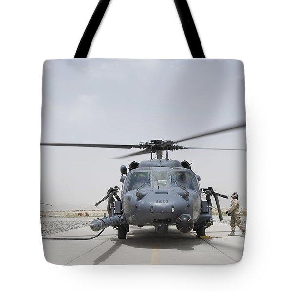 An Hh-60 Pave Hawk Lands After A Flight Tote Bag by Stocktrek Images