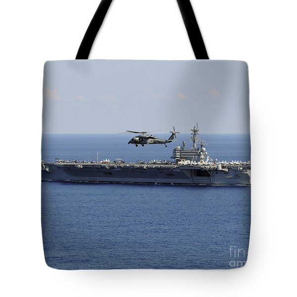 An Mh-60s Seahawk Helicopter Flies Tote Bag by Stocktrek Images
