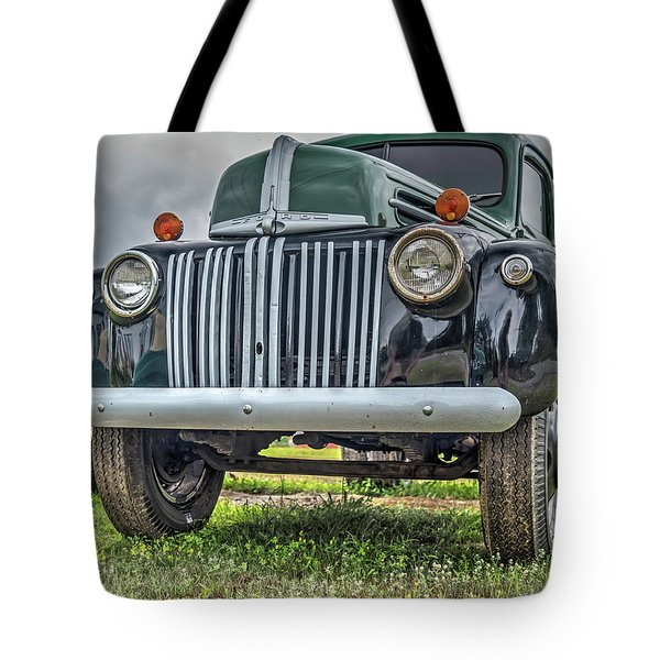 Tote Bag featuring the photograph An Old Green Ford Truck by Guy Whiteley