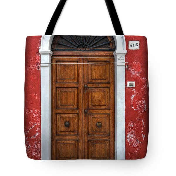 an old wooden door in Italy Tote Bag