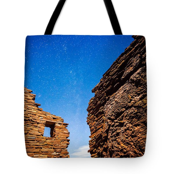 Tote Bag featuring the photograph Ancient Native American Pueblo Ruins And Stars At Night by Bryan Mullennix
