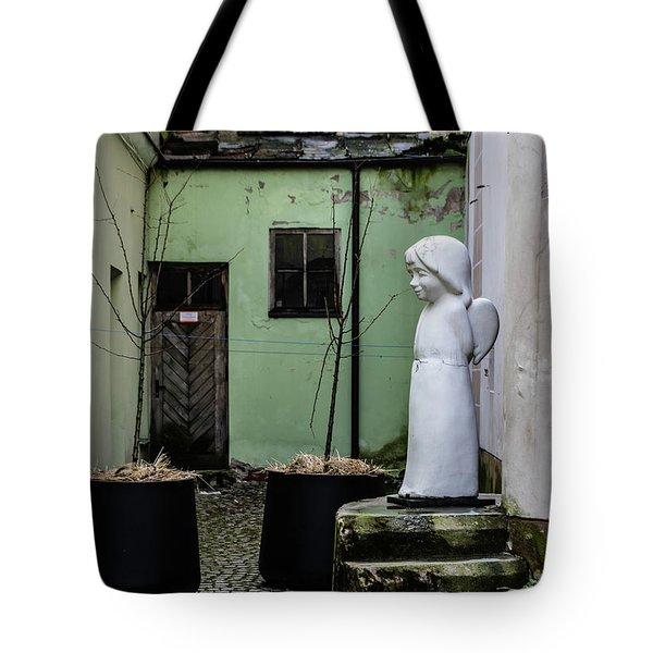 Angel In Courtyard Tote Bag