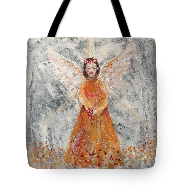 Angel In Orange Tote Bag by Jun Jamosmos