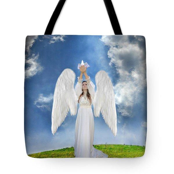 Angel Releasing A Dove Tote Bag by Jill Battaglia