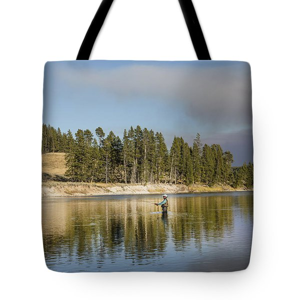 Angler Amidst Gorgeous Surroundings And A Calm River In The Yellowstone In Wyoming Tote Bag