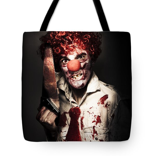 Angry Horror Clown Holding Butcher Saw In Darkness Tote Bag by Jorgo Photography - Wall Art Gallery