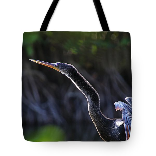 Tote Bag featuring the photograph Anhinga  by Michele A Loftus