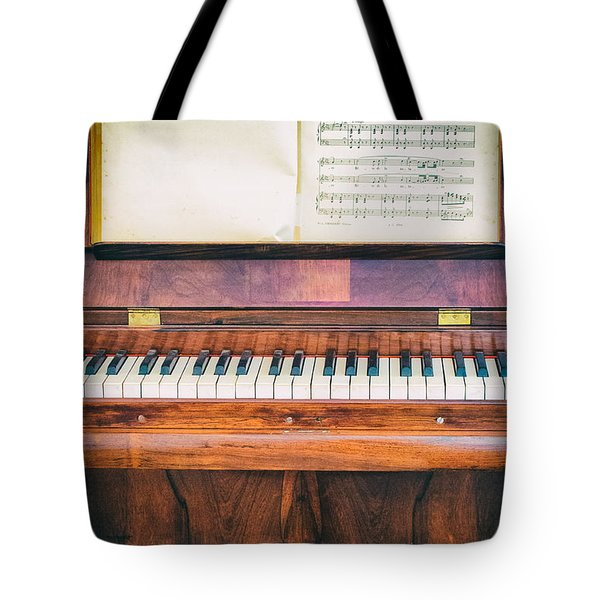 Tote Bag featuring the photograph Antique Piano And Music Sheet by Silvia Ganora