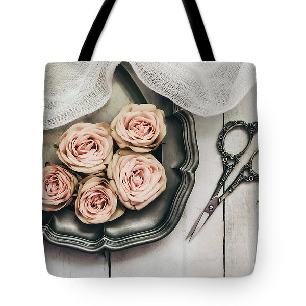 Tote Bag featuring the photograph Antiqued Roses by Kim Hojnacki
