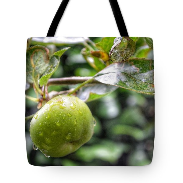Tote Bag featuring the photograph Apple In Rain by Isabella F Abbie Shores FRSA