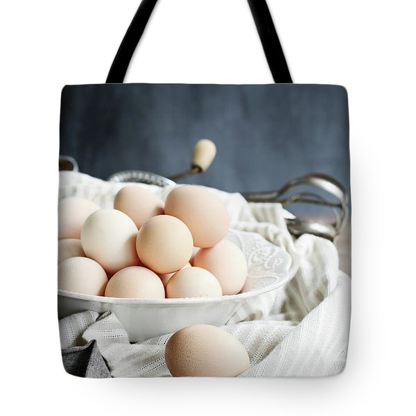 Apron And Eggs On Wooden Table Tote Bag