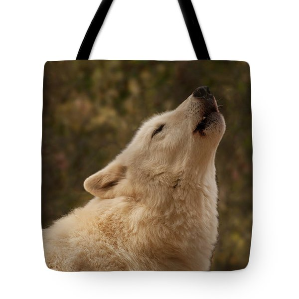 Tote Bag featuring the photograph Arctic Wolf Howling by Chris Flees