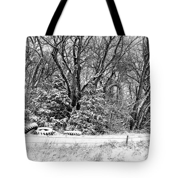Three Tires And A Snowstorm Tote Bag by Bill Kesler