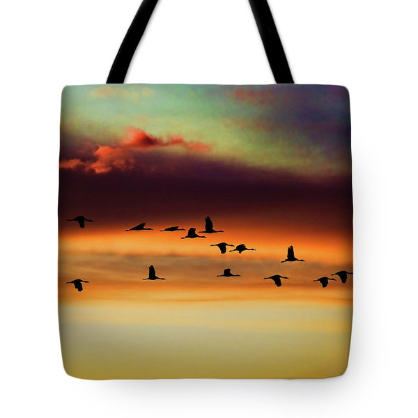 Sandhill Cranes Take The Sunset Flight Tote Bag