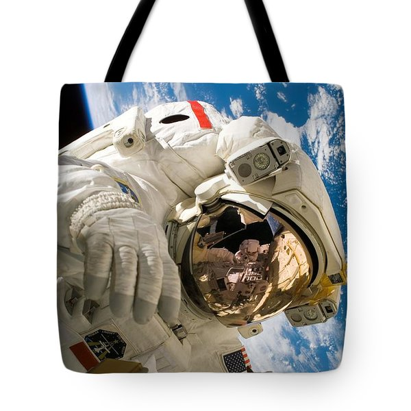 Astronaut During The Third Spacewalk Of Sts-121 Tote Bag