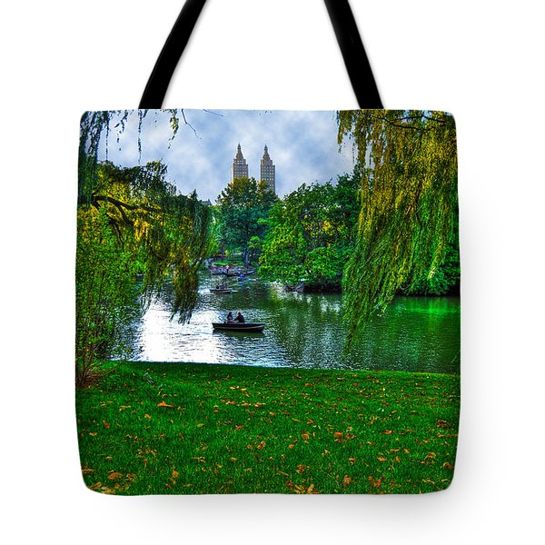 At The Lake In Central Park Tote Bag by Randy Aveille