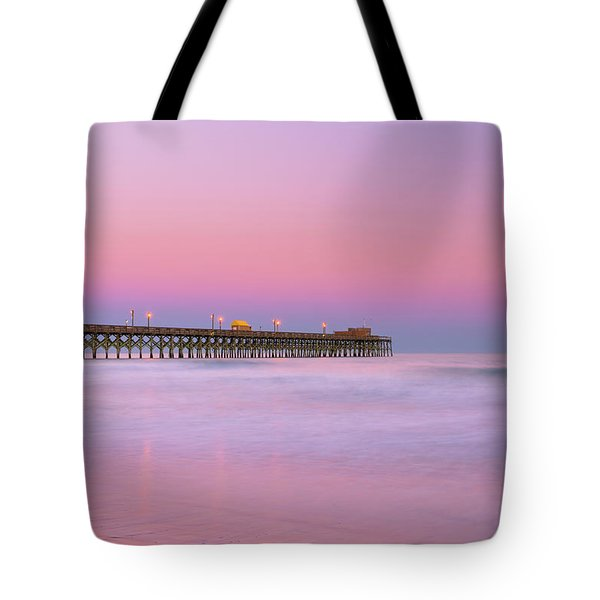 Tote Bag featuring the photograph Atlantic Ocean And The Apache Pier At Sunset In South Carolina by Ranjay Mitra