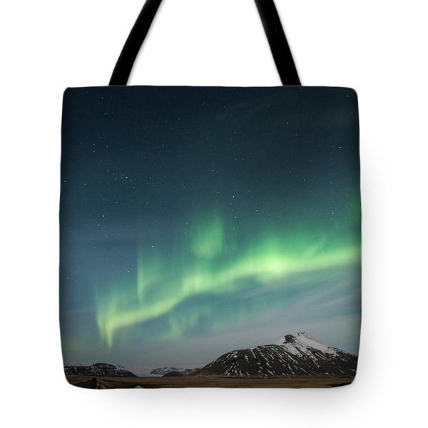 Tote Bag featuring the photograph Aurora Borealis Over Iceland by Sandra Bronstein
