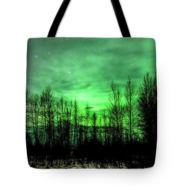 Tote Bag featuring the photograph Aurora In The Clouds by Bryan Carter
