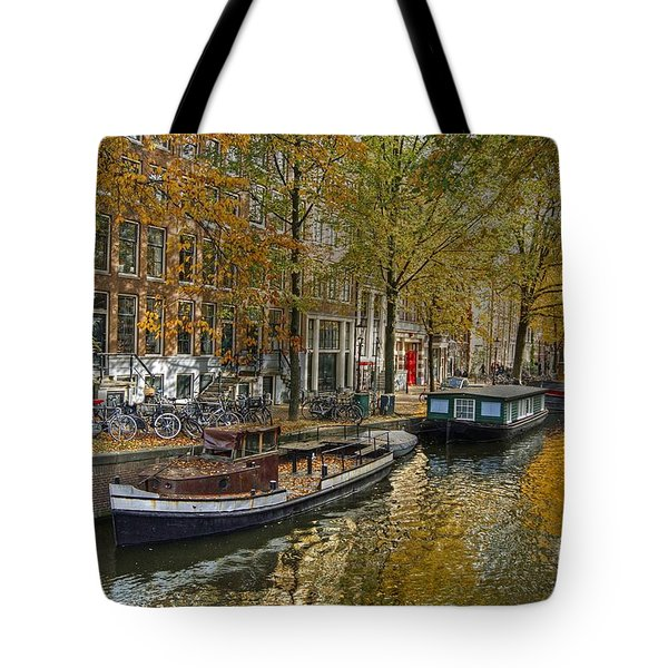 Tote Bag featuring the photograph Autumn In Amsterdam by David Birchall