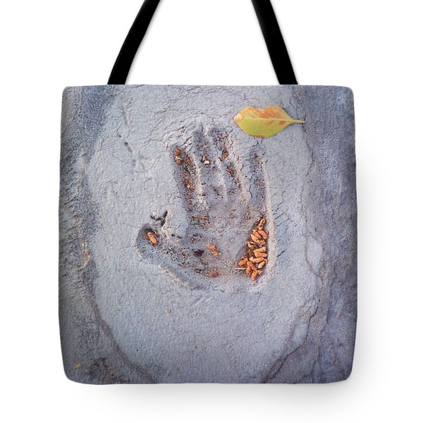 Autumns Child Or Hand In Concrete Tote Bag by Heather Kirk
