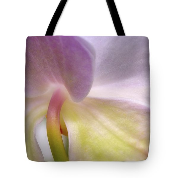 Tote Bag featuring the photograph Backlit Orchid by Michael Hubley
