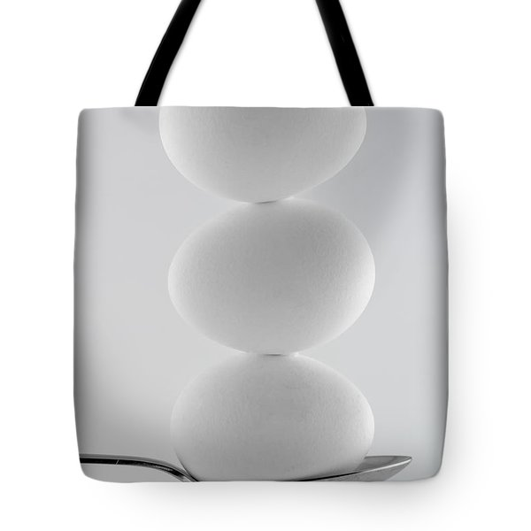 Balancing Eggs Tote Bag by Gert Lavsen