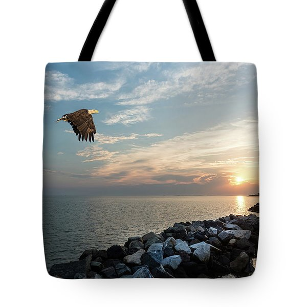 Bald Eagle Flying Over A Jetty At Sunset Tote Bag