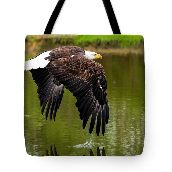 Bald Eagle Over A Pond Tote Bag