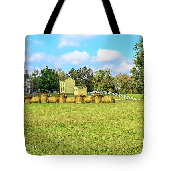 Tote Bag featuring the photograph Baled Hay In A Grassy Field by Richard J Thompson