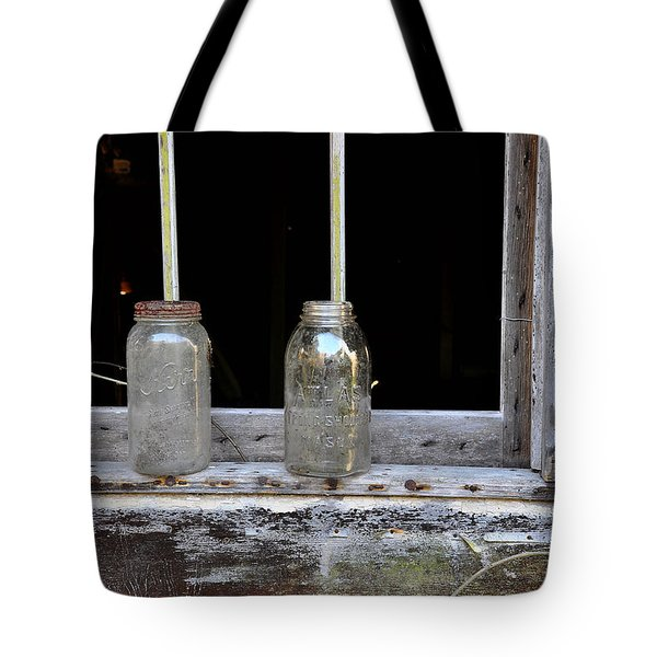 Ball And Atlas Tote Bag by Todd Hostetter