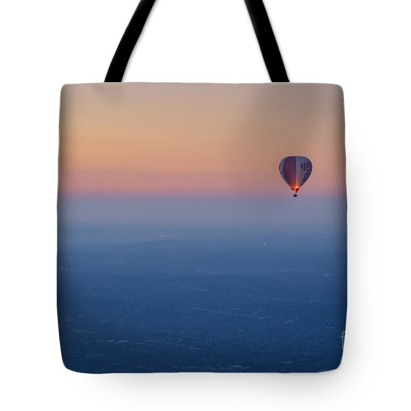 Tote Bag featuring the photograph Ballooning In The Haze by Ray Warren