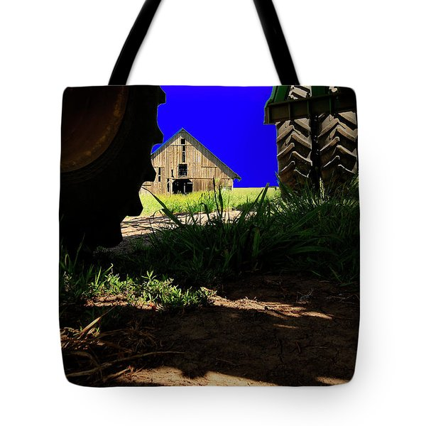 Tote Bag featuring the photograph Barn From Under The Equipment by Bob Cournoyer