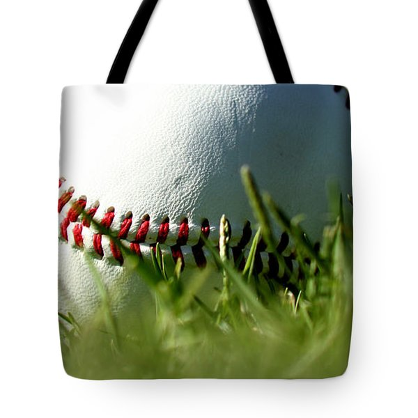 Baseball In Grass Tote Bag by Chris Brannen