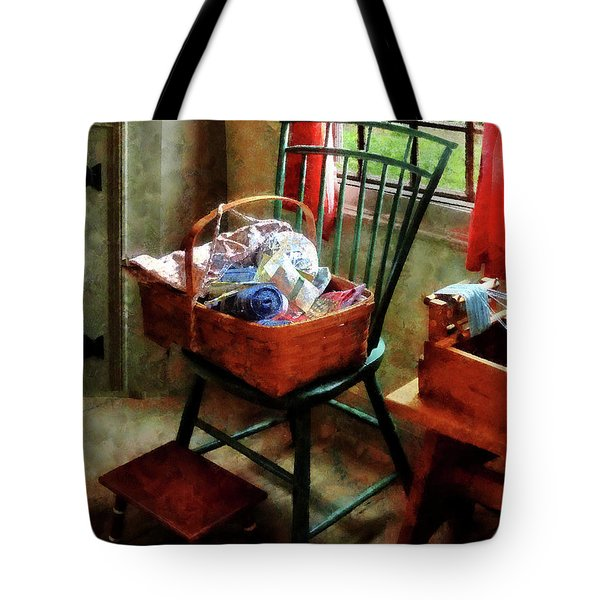 Basket Of Cloth And Yarn On Chair Tote Bag by Susan Savad