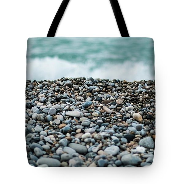 Tote Bag featuring the photograph Beach Pebbles by MGL Meiklejohn Graphics Licensing