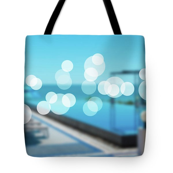 Tote Bag featuring the photograph Beach Resort Concept by Atiketta Sangasaeng
