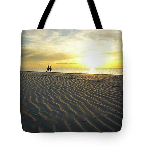Beach Silhouettes And Sand Ripples At Sunset Tote Bag